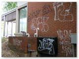 Brick Wall Graffiti Removal - Before